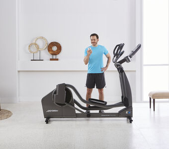 Lifestyle Male looking at phone E5 Cross Trainer 6754 mr